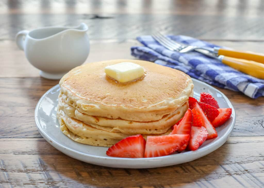 Light and Fluffy Whole Wheat Pancakes? Yes! - get the recipe at barefeetinthekitchen.com