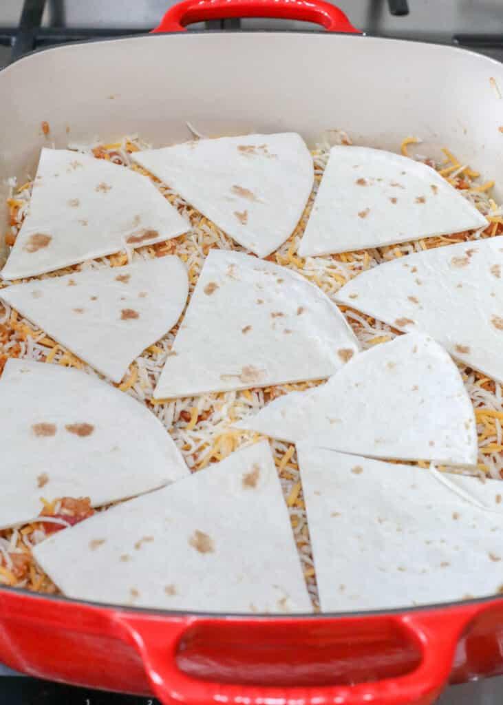 Cutting the tortillas into wedges makes layering the casserole easier and simpler to serve as well.