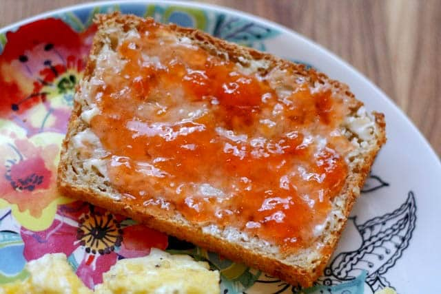 Homemade Peach Jam on toast is a treat! get the recipe at barefeetinthekitchen.com