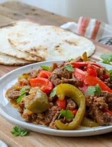 Steak Fajitas made in the crockpot are a family favorite! get the recipe at barefeetinthekitchen.com