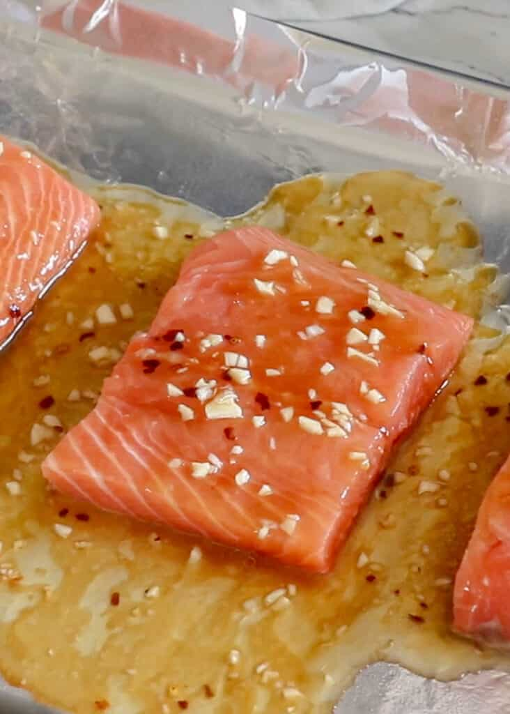 Sweet and Spicy Glazed Salmon - get the recipe at barefeetinthekitchen.com