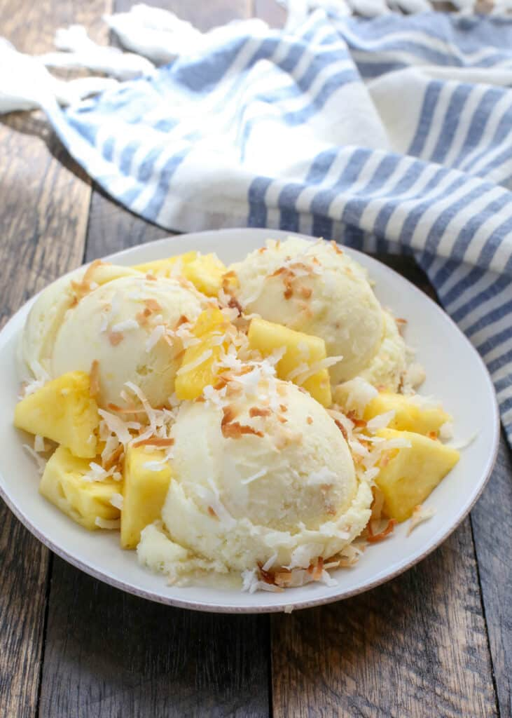 Pineapple + Coconut = the ultimate Pina Colada Ice Cream - get the recipe at barefeetinthekitchen.com
