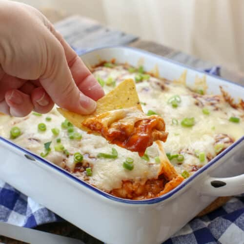Barbecue Chicken Enchiladas are cheesy and delicious! get the recipe at barefeetinthekitchen.com