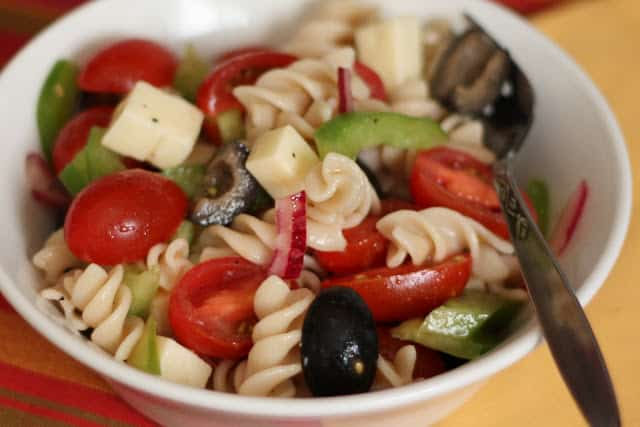 Tangy Pasta Salad with Tomatoes, Peppers and Olives recipe by Barefeet In The Kitchen