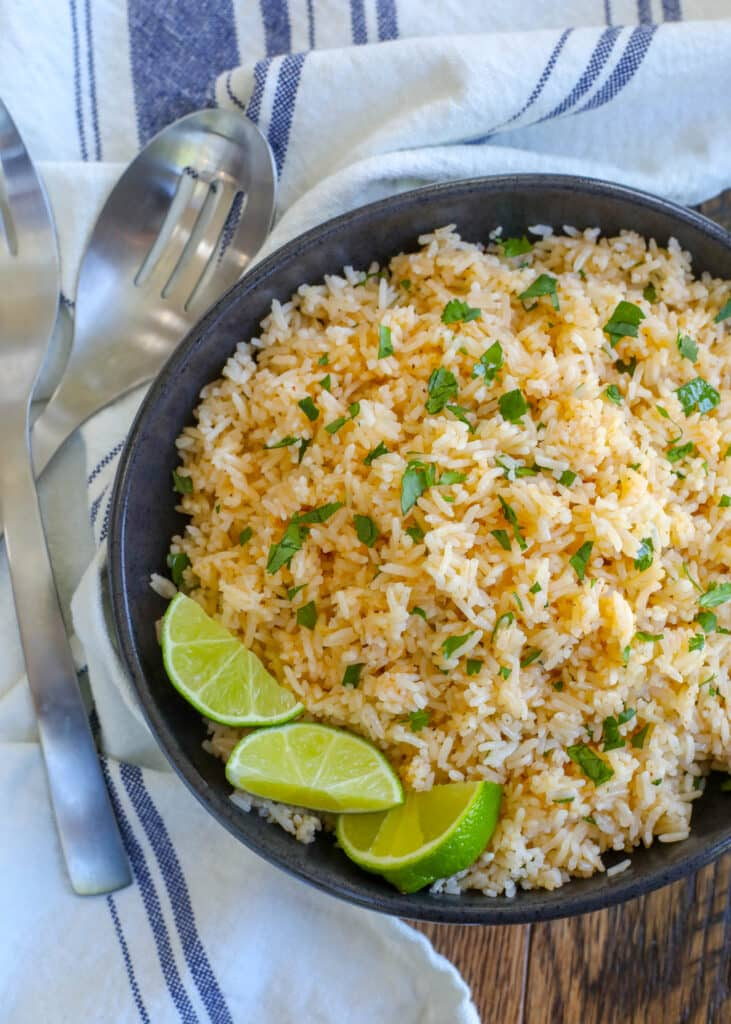 Chipotle and Lime Rice is a quick and easy way to wake up your rice side dish! - get the recipe at barefeetinthekitchen.com