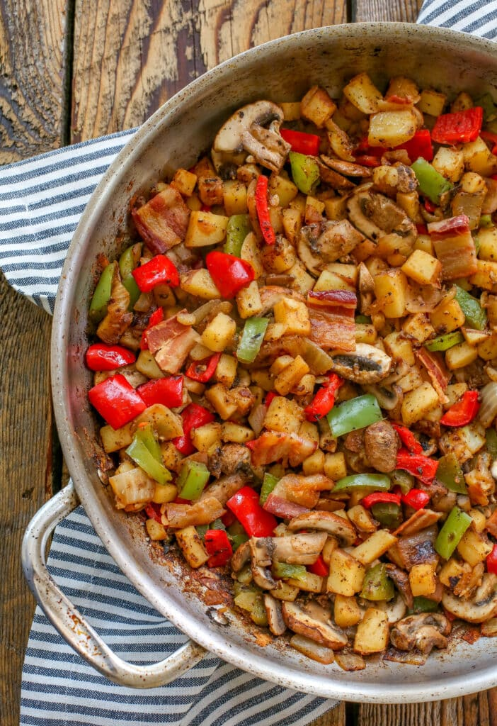 Crispy Potato and Vegetable Hash - topped with an egg, this is a skillet meal to make over and over again.