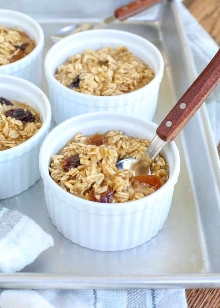 Chewy Baked Oatmeal filled with raisins is a breakfast favorite! get the recipe at barefeetinthekitchen.com