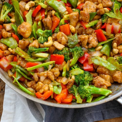 Honey Sriracha Cashew Chicken in just 30 minutes! get the recipe at barefeetinthekitchen.com