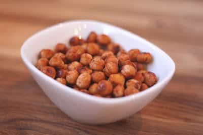 A bowl of food on a plate, with Chickpea