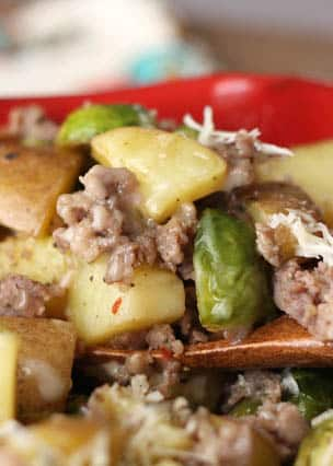 Roasted Potatoes with Brussels Sprouts and Sausage is a hearty meal perfect for a cold night! Get the recipe at barefeetinthekitchen.com