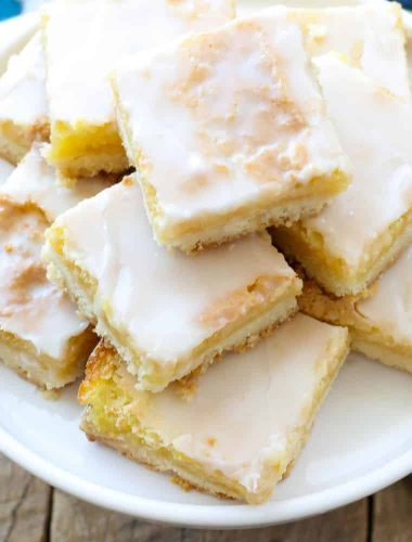 Sunburst Lemon Bars are a dreamy dessert that no one is able to resist! get the recipe at barefeetinthekitchen.com