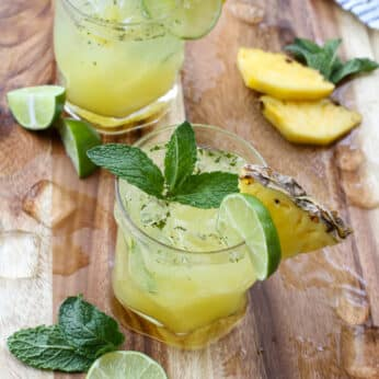 "Pineapple Mojitos are a favorite for all ages - the ""mocktail"" is every bit as delicious as the cocktail! get the recipe at barefeetinthekitchen.com"
