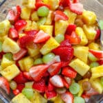 Pineapple, berries, and grapes are tossed in a honey lime dressing