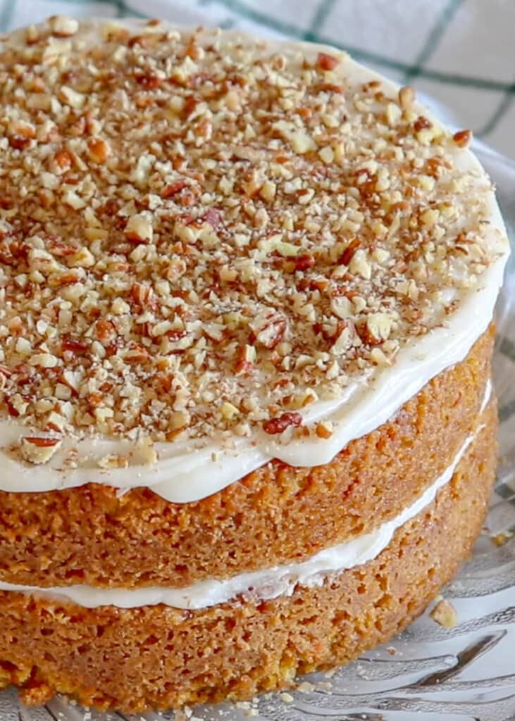 This Carrot Cake is everything I want in a dessert! Topped with cream cheese frosting, it's pure heaven! get the recipe at barefeetinthekitchen.com