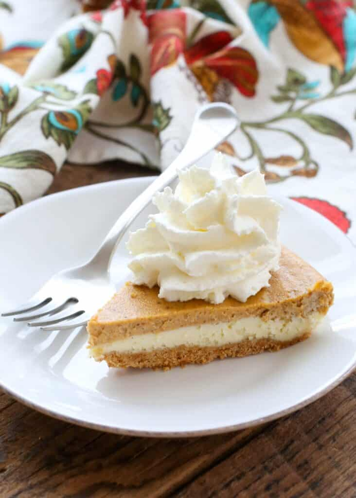 A piece of cake on a plate, with Pumpkin and Cheesecake