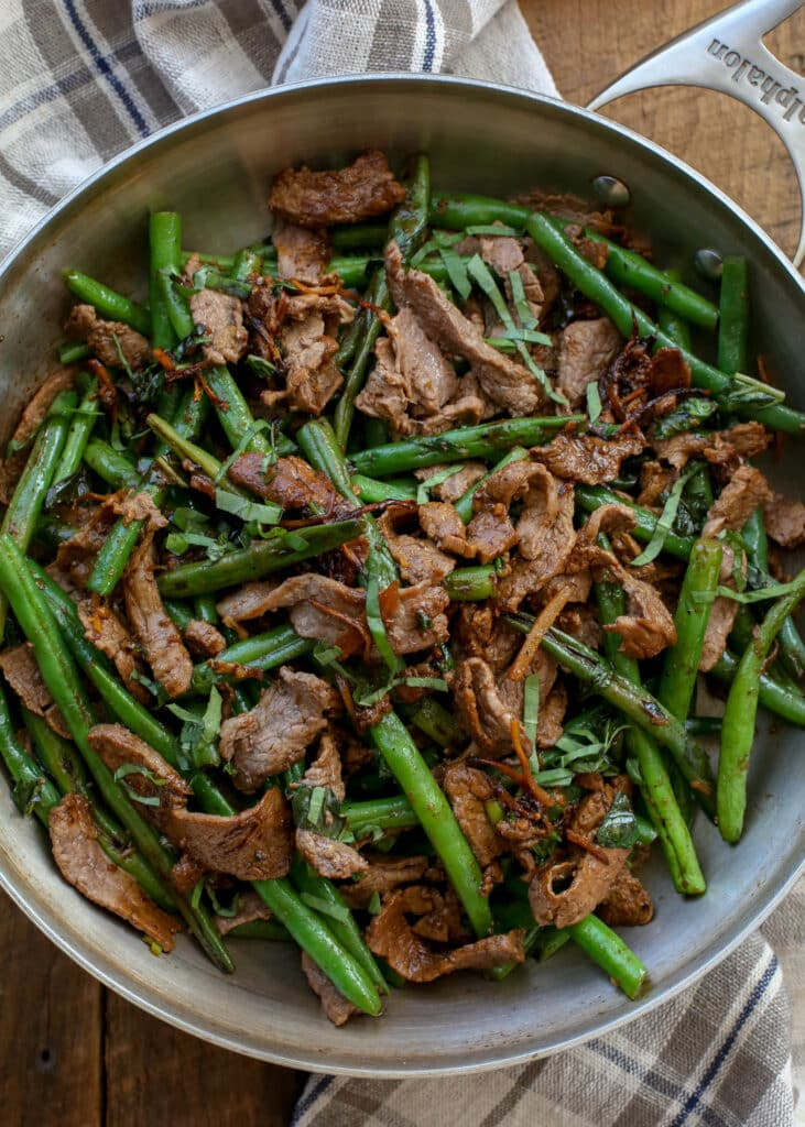 Thai Steak with Green Beans is an easy weeknight dinner that only requires a handful of ingredients and a few minutes effort! get the recipe at barefeetinthekitchen.com
