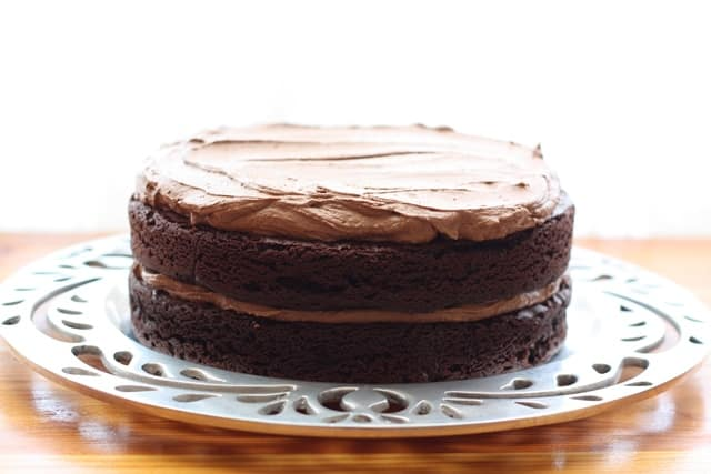 A piece of chocolate cake on a plate, with Quinoa and Flour