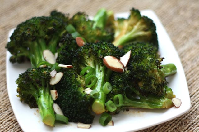 A plate of food with broccoli, with Sauce and Salad