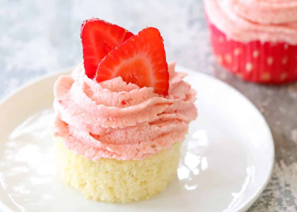 Fresh Strawberry Frosting is everyone's favorite! get the recipe at barefeetinthekitchen.com