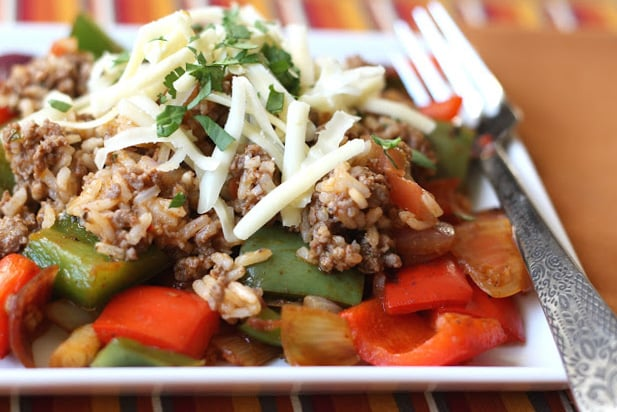 A dish is filled with food, with Peppers and Bell pepper