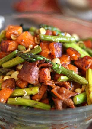 Tender, slightly browned sweet potatoes, salty bacon pieces, fresh corn cooked just until warm and asparagus that is tender and still just a little bit crisp are all tossed together with just a drizzle of balsamic to make this Asparagus, Bacon, Corn, and Sweet Potato Skillet.