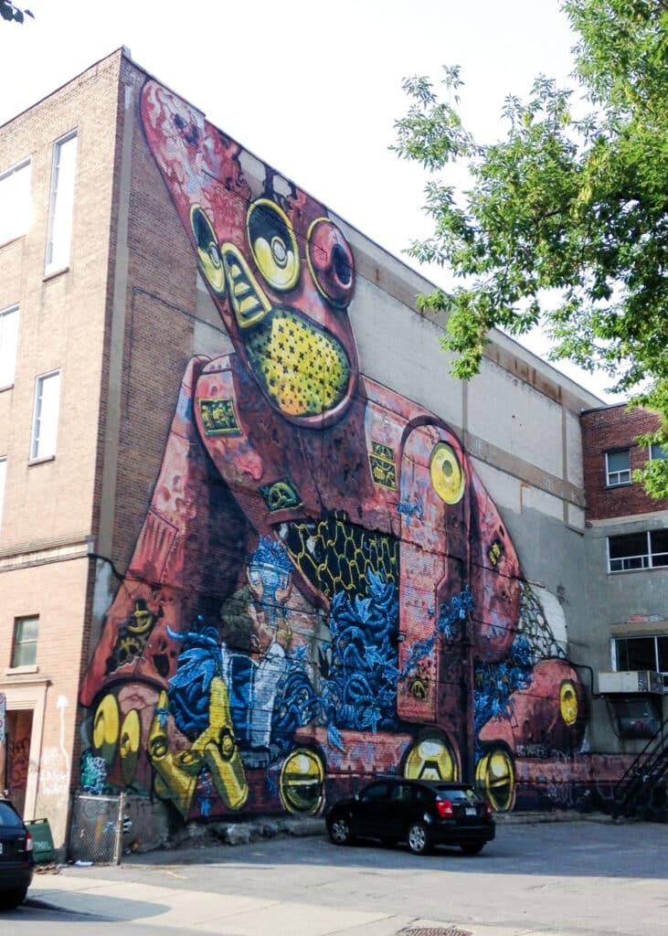 Montreal street art mural by Italian painter Pixel Pancho