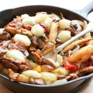 Montreal-Style Poutine with Bacon, Peppers, Mushrooms, and Onions