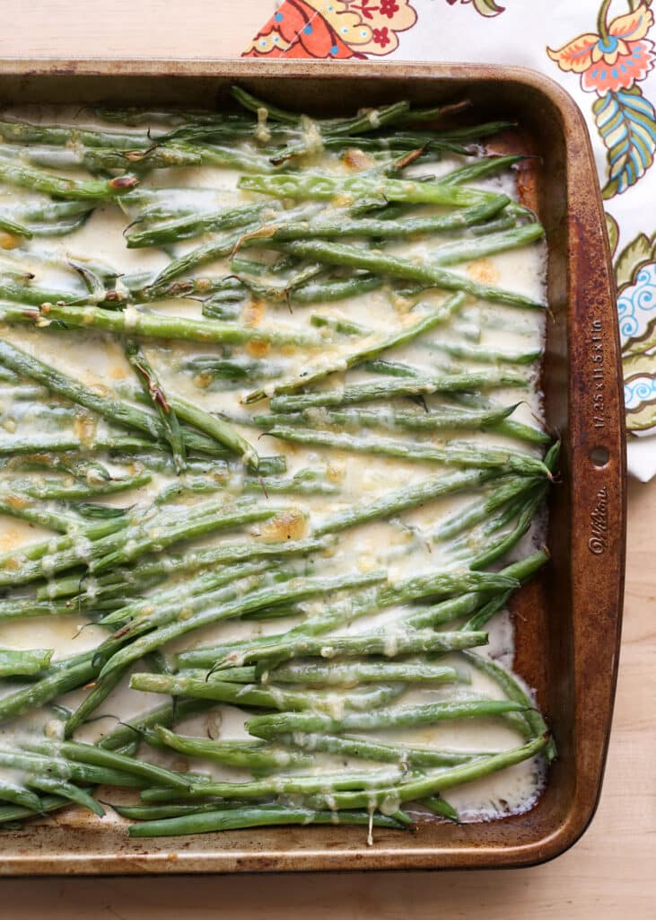 Crispy roasted green beans in a creamy cheese sauce, this Green Bean Gratin is perfect for any occasion!