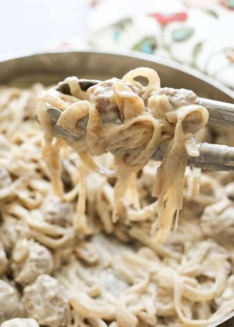 Bite size meatballs, sautéed mushrooms, and fettuccine noodles are smothered in a creamy classic stroganoff sauce to make this Meatball Stroganoff Fettuccine - by Barefeet In The Kitchen