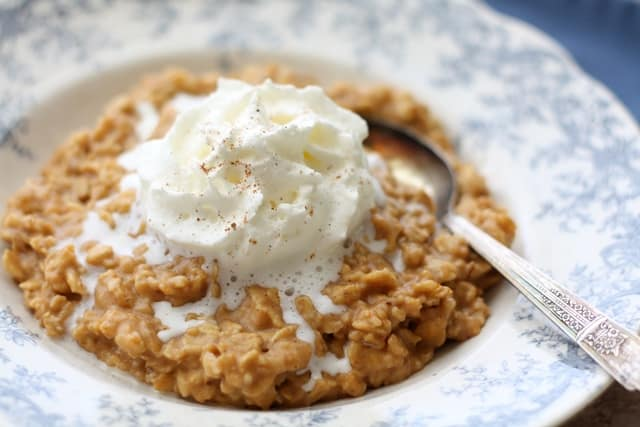 Pumpkin Pie Oatmeal with Vanilla Whipped Cream