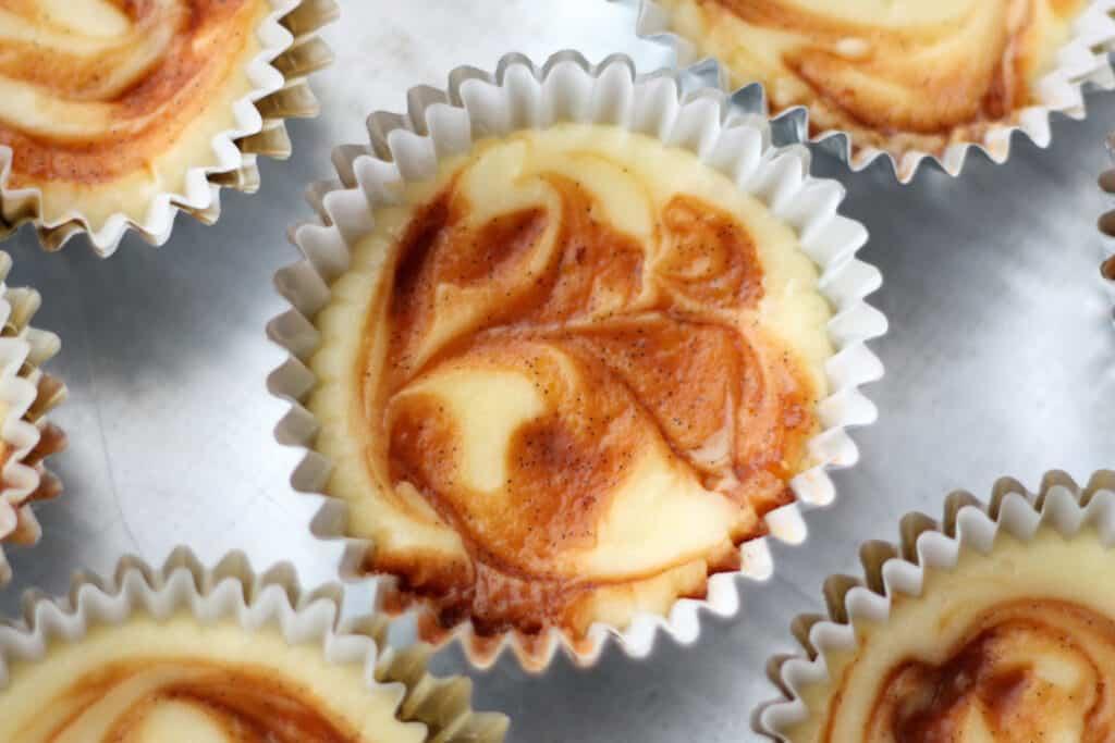 Caramel Swirl Cheesecake Cupcakes | get the recipe now at barefeetinthekitchen.com