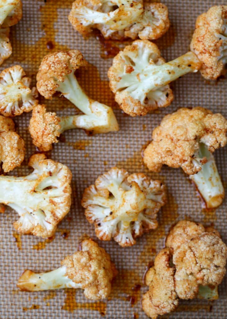 Garlic and Paprika Roasted Cauliflower is irresistible! - get the recipe at barefeetinthekitchen.com