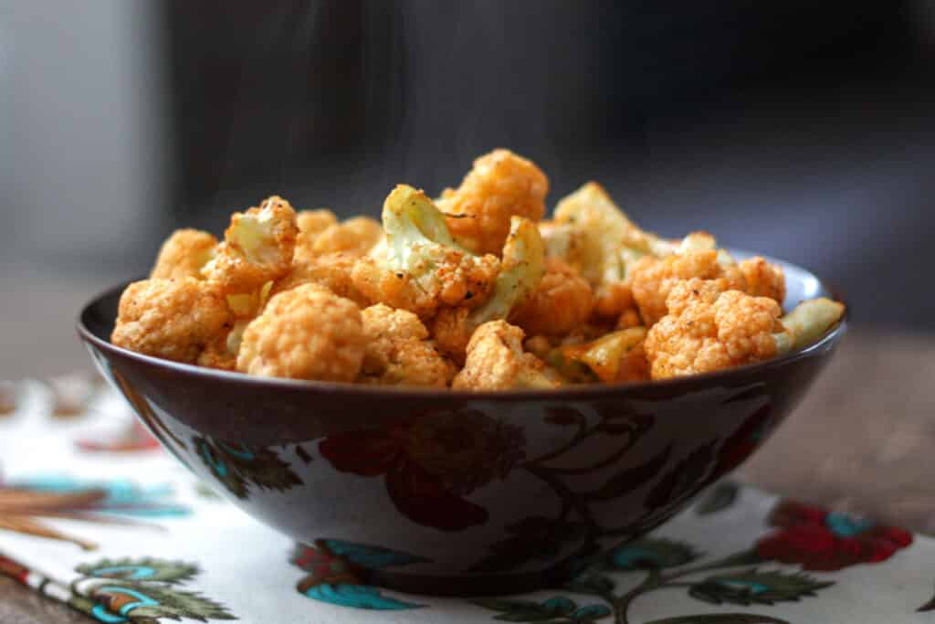 Garlic and Paprika Roasted Cauliflower - get the recipe at barefeetinthekitchen.com