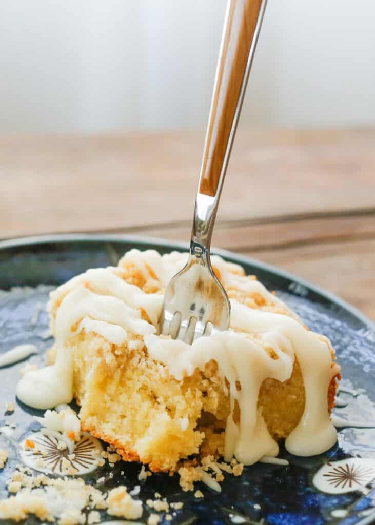 Lemon Coffee Cake with a warm lemon butter glaze - get the recipe at barefeetinthekitchen.com