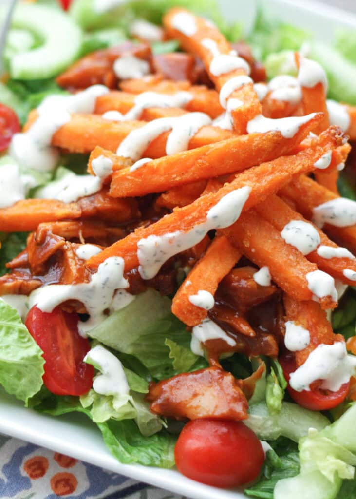 BBQ Chicken Salad with Sweet Potato Fries is like no other salad you've ever tasted! - get the recipe at barefeetinthekitchen.com