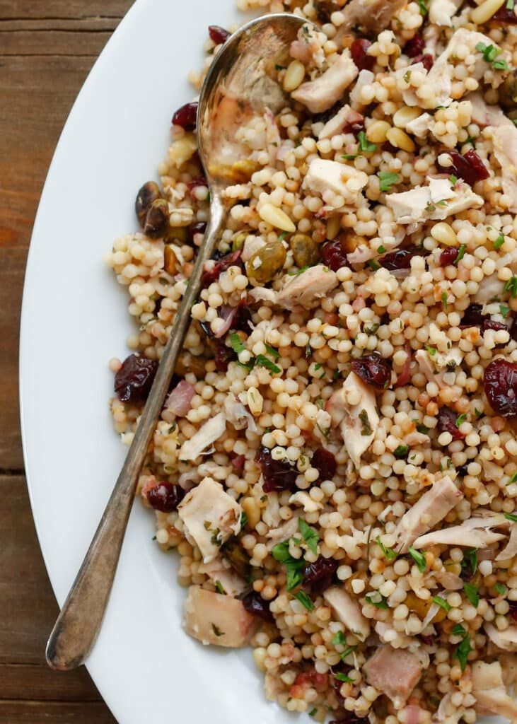 Lemon Couscous filled with craisins, chicken, pistachios and more - get the recipe at barefeetinthekitchen.com
