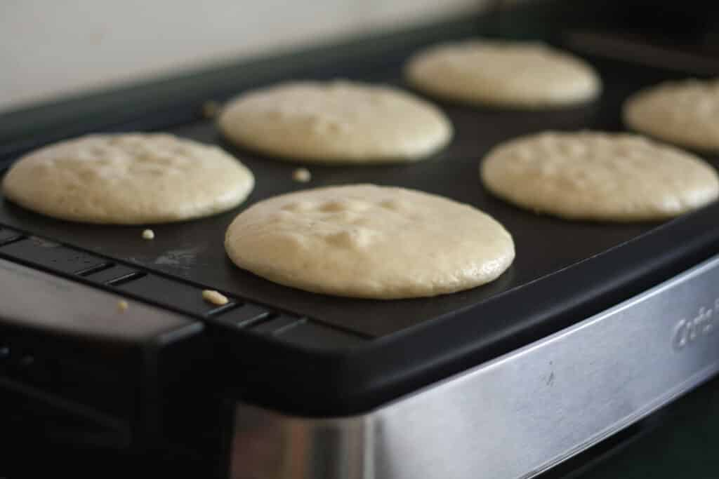 These Light and Fluffy Gluten Free Pancakes turn out perfectly every time! get the recipe at barefeetinthekitchen.com