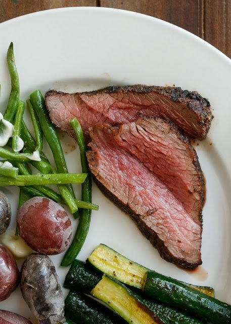 How to grill juicy tri-tip steak tender enough to cut with a fork - get the recipe at barefeetinthekitchen.com