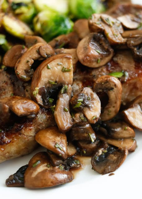 Rosemary Mushrooms (perfect over steaks or on their own) - get the recipe at barefeetinthekitchen.com