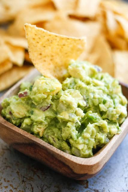 This Spicy Guacamole is perfect for snacking, topping your burgers, and possibly just eating with a spoon! get the recipe at barefeetinthekitchen.com
