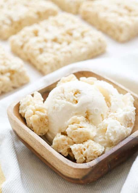 Rice Krispy Treat Ice Cream is smooth, creamy vanilla ice cream filled with chewy bites of rice krispy treats! get the recipe at barefeetinthekitchen.com