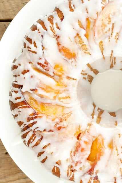 Summer Pound Cake with Caramelized Peaches and Almond Glaze - get the recipe at barefeetinthekitchen.com