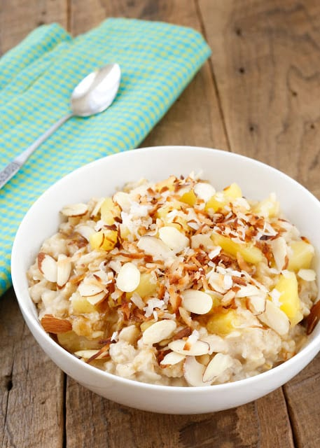 Hawaiian Oatmeal is a creamy oatmeal filled with juicy bits of pineapple, chewy nuts, a sprinkling of coconut, and a dusting of brown sugar! Get the recipe at barefeetinthekitchen.com