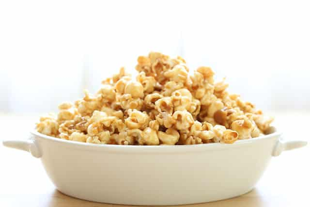 A bowl of food, with Caramel and Popcorn