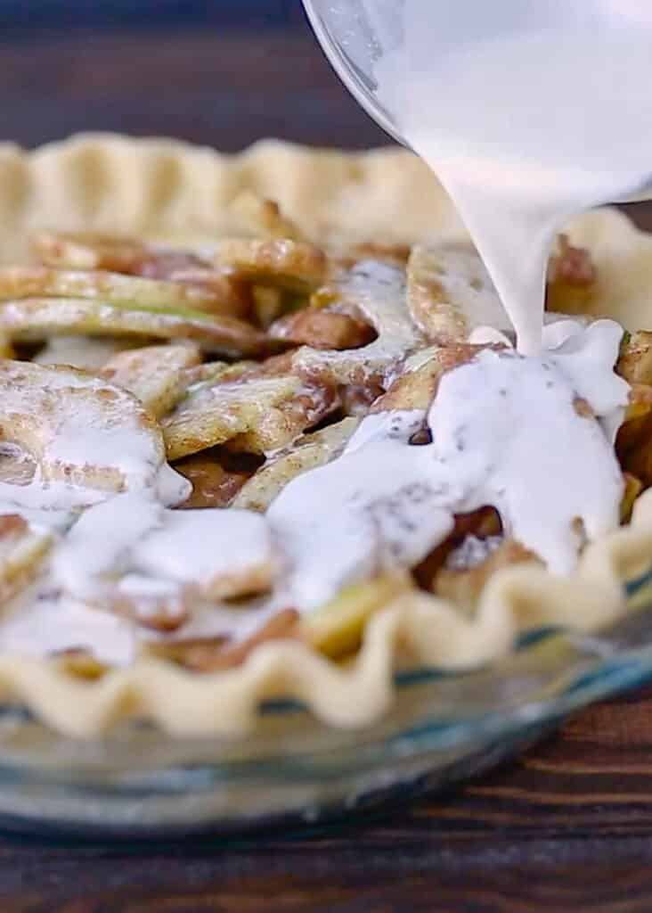 With little more than a pie crust, apples, cinnamon sugar spices, and a bit of cream, you can make an unforgettable German Apple Pie!