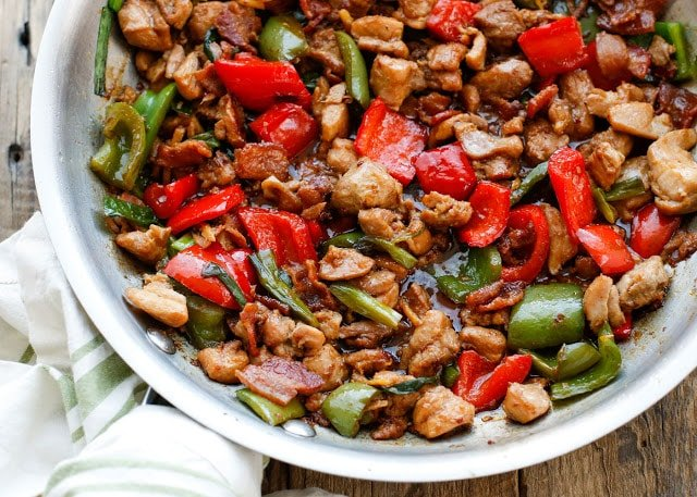Tender bites of chicken, salty bacon, and crisp bell peppers are tossed in a fantastic sweet and spicy sauce to make this Spicy Chicken and Bacon Stir-Fry - get the recipe at barefeetinthekitchen.com