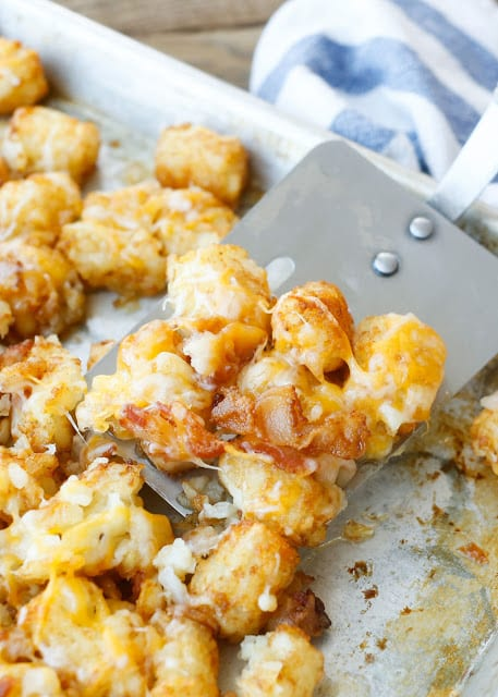 Everyone LOVES these Cheesy Bacon Tater Tots! Get the recipe at barefeetinthekitchen.com