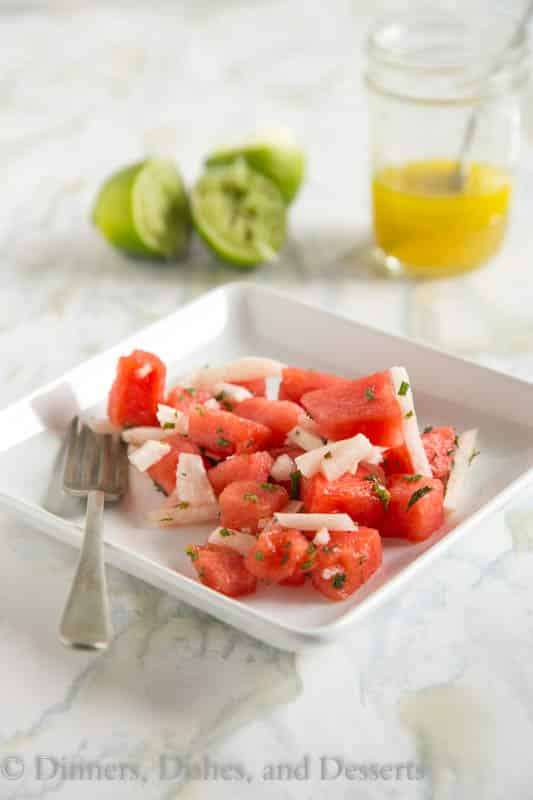 Jicima and Watermelon Salad - use juicy watermelon and slightly sweet jicima to make a great summer side dish. Toss with a honey-lime vinaigrette.