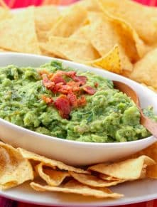 Best Ever Roasted Garlic Guacamole with Bacon