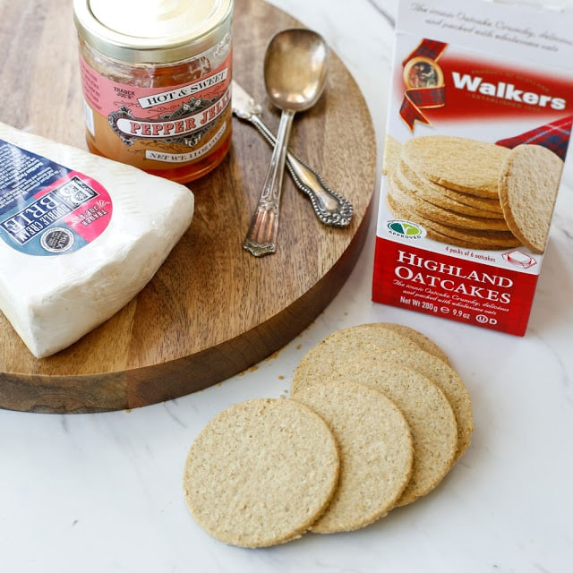 Savory oat crackers topped with creamy brie and sweetly spiced jam - get the recipe at barefeetinthekitchen.com
